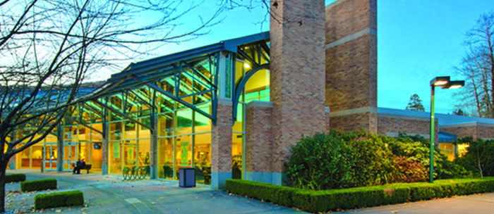 exterior of Port Moody Public Library building in the evening