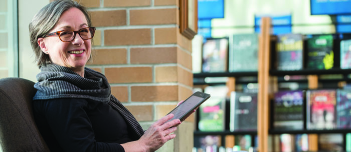 woman reading an ebook on a tablet