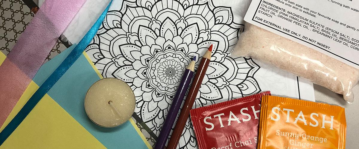 Candle, tea bags, bath salt, colouring pages